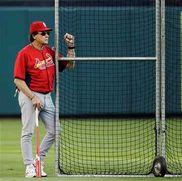 St. Louis Cardinals manager Tony La Russa watches some players before Game 4 of baseball's World Series against the Texas Rangers Sunday, Oct. 23, 2011, in Arlington, Texas. (AP Photo/Paul Sancya) By Paul Sancya