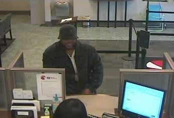 Security camera photos of a bank robbery suspect at the St. Louis Community Credit Union on March 25, 2010. By Bryce Moore