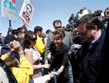 "Sarah Palin, center, greets with Tea Party activists after speaking at the ""Showdown in Searchlight"" tea party rally in Searchlight, Nev., Saturday, March 27, 2010. (AP Photo/Jae C. Hong) By Jae C. Hong"