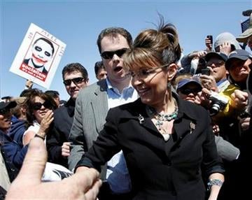 "Sarah Palin, center, greets Tea Party activists after speaking at the ""Showdown in Searchlight"" tea party rally in Searchlight, Nev., Saturday, March 27, 2010. (AP Photo/Jae C. Hong) By Jae C. Hong"