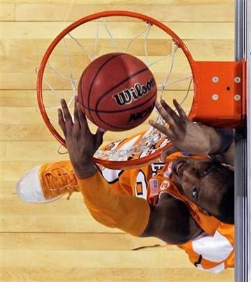 Tennessee's J.P. Prince dunks against Michigan State during the first half of the NCAA Midwest Regional college basketball championship game Sunday, March 28, 2010, in St. Louis. (AP Photo/Paul Sancya) By Paul Sancya