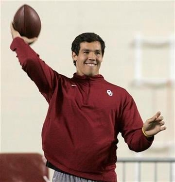 Former Oklahoma quarterback Sam Bradford, warms up prior to working out for NFL scouts at in Norman, Okla., Monday, March 29, 2010. (AP Photo/Sue Ogrocki) By Sue Ogrocki