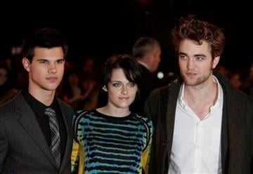 From left to right, actors Taylor Lautner, Kristen Stewart and Robert Pattinson pose for the photographers prior to the UK fan party  of their new film 'New Moon' in London, Wednesday Nov. 11, 2009. (AP Photo/Lefteris Pitarakis) By LEFTERIS PITARAKIS