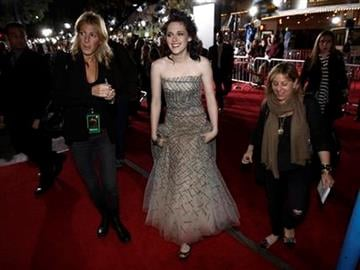 Kristen Stewart, center, arrives at The Twilight Saga: New Moon premiere on Monday, Nov. 16,  2009, in Westwood, Calif.  (AP Photo/Chris Pizzello) By Chris Pizzello