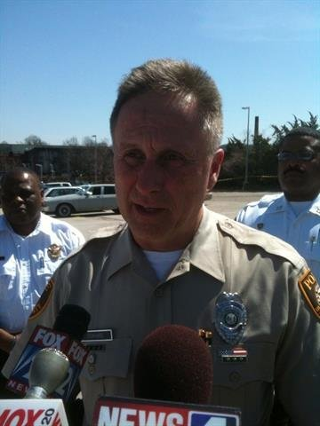 Officer Rick Eckhard addresses reporters following a shooting in the Wellston Metrolink parking lot. By Afton Spriggs