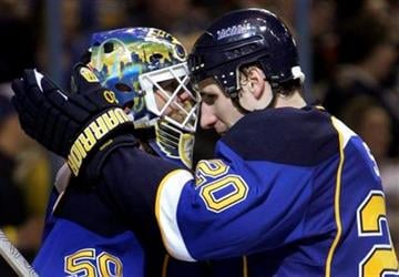 St. Louis Blues goalie Chris Mason, left, and teammate Alexander Steen celebrate the Blues' 4-2 victory over the Chicago Blackhawks in an NHL hockey game Tuesday, March 30, 2010, in St. Louis. (AP Photo/Jeff Roberson) By Jeff Roberson