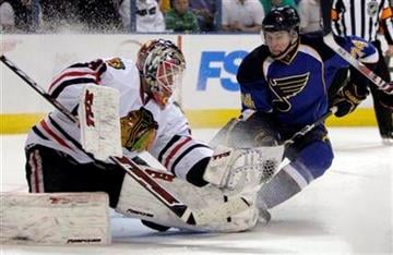 Chicago Blackhawks goalie Antti Niemi, of Finland, makes a glove save as St. Louis Blues' T.J. Oshie, right, skates in during the second period of an NHL hockey game Tuesday, March 30, 2010, in St. Louis. (AP Photo/Jeff Roberson) By Jeff Roberson