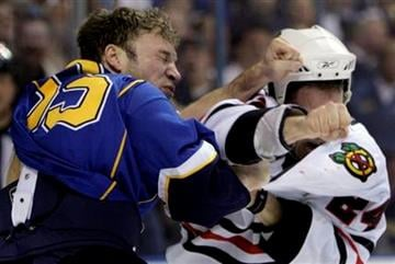 St. Louis Blues' Cam Janssen, left, and Chicago Blackhawks' Nick Boynton fight during the second period of an NHL hockey game Tuesday, March 30, 2010, in St. Louis. (AP Photo/Jeff Roberson) By Jeff Roberson