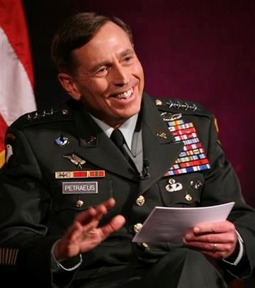 Gen. David Petraeus smiles after making a joke during a talk at Saint Anslem College in Manchester, N.H., Wednesday, March 24, 2010.  (AP Photo/Jim Cole) By Jim Cole