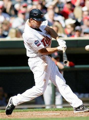 Minnesota Twins J.J. Hardy hits a single in the fourth inning against the St. Louis Cardinals at Target Field during spring baseball action in Minneapolis Saturday, April 3, 2010. The Twins defeated the Cardinals 8-3.(AP Photo/Andy King) By Andy King