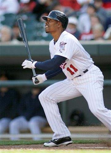 Minnesota Twins' Jacque Jones hits a single in the seventh inning against the St. Louis Cardinals at Target Field during a spring baseball game in Minneapolis Saturday, April 3, 2010. The Twins defeated the Cardinals 8-3. (AP Photo/Andy King) By Andy King