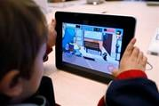 """Rowan Hall, 5, plays a game based on the popular animated series """"The Simpsons"""", on an Apple iPad on its first day of release at an Apple store in San Francisco, Saturday, April 3, 2010. (AP Photo/Paul Sakuma) By Paul Sakuma"""