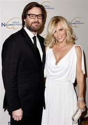 FILE - In this Oct. 1, 2009 file photo, Jim Carrey, left, and Jenny McCarthy arrive at the UCLA Department of Neurosurgery 2009 Visionary Ball in Beverly Hills, Calif.  (AP Photo/Matt Sayles, file) By Matt Sayles