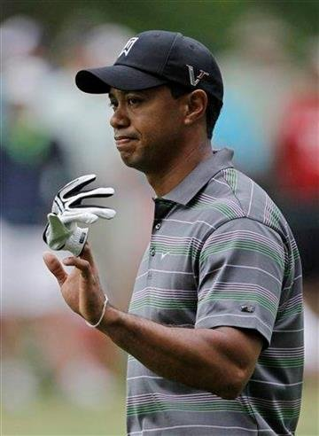 Tiger Woods waves to spectators as he walks down the second fairway during the first round of the Masters golf tournament in Augusta, Ga., Thursday, April 8, 2010. (AP Photo/Morry Gash) By Morry Gash