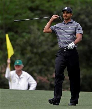 Tiger Woods walks down the second fairway after teeing off during the first round of the Masters golf tournament in Augusta, Ga., Thursday, April 8, 2010. (AP Photo/Morry Gash) By Morry Gash