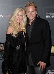 In this photo taken on May 14, 2009, television personality Heidi Montag and television personality Spencer Pratt arrive at the T-Mobile Sidekick LX Launch Party in Los Angeles. (AP Photo/Dan Steinberg) By DAN STEINBERG