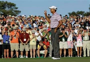 Tiger Woods waves to spectators on the 18th green after his third round of the Masters golf tournament in Augusta, Ga., Saturday, April 10, 2010. (AP Photo/David J. Phillip) By David J. Phillip