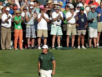 Spectators applaud as Phil Mickelson walks up the 16th fairway during the third round of the Masters golf tournament in Augusta, Ga., Saturday, April 10, 2010. (AP Photo/Charlie Riedel) By David J. Phillip