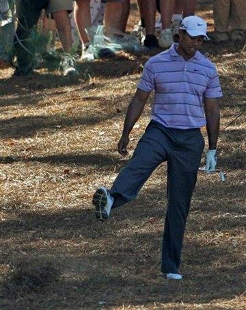 Tiger Woods kicks debris after his shot out of the rough off the ninth fairway during the third round of the Masters golf tournament in Augusta, Ga., Saturday, April 10, 2010. (AP Photo/Charlie Riedel) By Charlie Riedel
