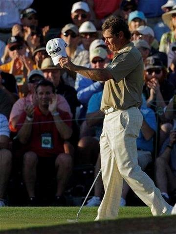 Lee Westwood of England acknowledges applause on the 18th hole after his third round of the Masters golf tournament in Augusta, Ga., Saturday, April 10, 2010. (AP Photo/Charlie Riedel) By Charlie Riedel