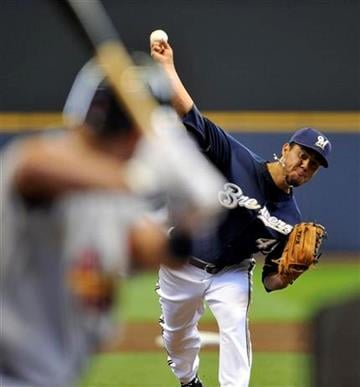 Milwaukee Brewers' Yovani Gallardo pitches against the St. Louis Cardinals during the first inning of a baseball game Saturday, April 10, 2010, in Milwaukee. (AP Photo/Jim Prisching) By Jim Prisching