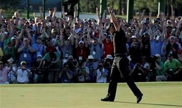 Phil Mickelson celebrates on the 18th green after winning the Masters golf tournament in Augusta, Ga., Sunday, April 11, 2010. (AP Photo/Rob Carr) By Rob Carr