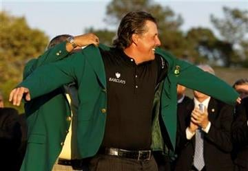 Phil Mickelson puts on the Masters jacket after winning the 2010 Masters golf tournament in Augusta, Ga., Sunday, April 11, 2010. (AP Photo/David J. Phillip) By David J. Phillip