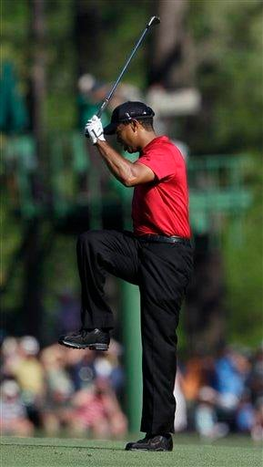 Tiger Woods reacts to his approach shot on the 13th fairway during the final round of the Masters golf tournament in Augusta, Ga., Sunday, April 11, 2010. (AP Photo/Charlie Riedel) By Charlie Riedel