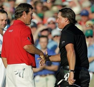 Phil Mickelson, right, shakes hands with Lee Westwood of England after winning the Masters golf tournament in Augusta, Ga., Sunday, April 11, 2010. (AP Photo/Morry Gash) By Morry Gash
