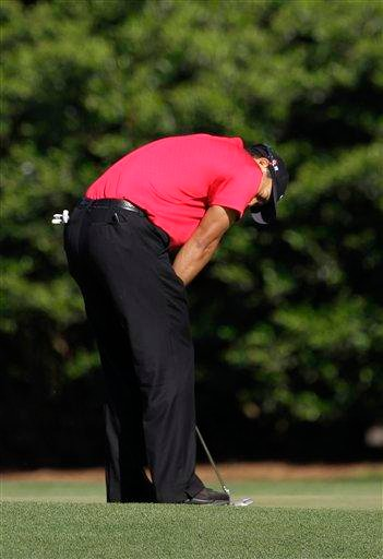 Tiger Woods reacts to a missed putt on the 11th green during the final round of the Masters golf tournament in Augusta, Ga., Sunday, April 11, 2010. (AP Photo/Rob Carr) By Rob Carr