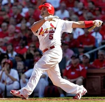 St. Louis Cardinals' Albert Pujols hits a three-run home run during the third inning of a baseball game against the Houston Astros Monday, April 12, 2010, in St. Louis. (AP Photo/Jeff Roberson) By Jeff Roberson