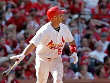 St. Louis Cardinals' Albert Pujols watches his three-run home run in the third inning of a baseball game against the Houston Astros, Monday, April 12, 2010 in St. Louis.  (AP Photo/Tom Gannam) By Tom Gannam