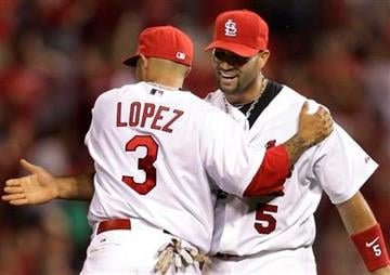 St. Louis Cardinals' Albert Pujols, right, and Felipe Lopez celebrate the Cardinals' 2-1 victory over the Houston Astros in a baseball game Wednesday, April 14, 2010, in St. Louis. (AP Photo/Jeff Roberson) By Jeff Roberson