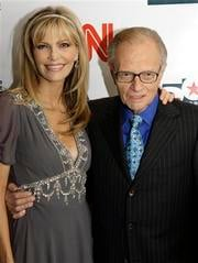 FILE - In this April 18, 2007 file photo, Larry King and his wife Shaun arrive to a party held by CNN celebrating King's fifty years of broadcasting, New York. ( AP Photo/Stuart Ramson, file) By Stuart Ramson