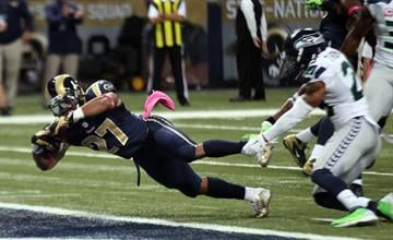 St. Louis Rams Tre Mason falls into the endzone for a touchdown in the first quarter against the Seattle Seahawks at the Edward Jones Dome in St. Louis on October 19, 2014.   UPI/Bill Greenblatt By BILL GREENBLATT