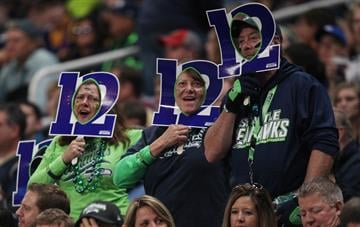 Seattle Seahawks fans try to get the 12th man cheer going in the first quarter against the St. Louis Rams at the Edward Jones Dome in St. Louis on October 19, 2014.   UPI/Bill Greenblatt By BILL GREENBLATT