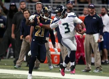 Seattle Seahawks quarterback Russell Wilson fights off St. Louis Rams Janooris Jenkins in the fourth  quarter at the Edward Jones Dome in St. Louis on October 19, 2014. St. Louis won the game 28-26.     UPI/Bill Greenblatt By BILL GREENBLATT