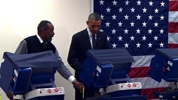 President Obama votes in 2014 Illinois election. By POOL