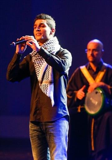 SAO PAULO, BRAZIL - JUNE 10:  Singer Mohammed Assaf performs during the opening ceremony of the 64th FIFA Congress at the Expocenter Transamerica on June 10, 2014 in Sao Paulo, Brazil.  (Photo by Alexandre Schneider/Getty Images) By Alexandre Schneider