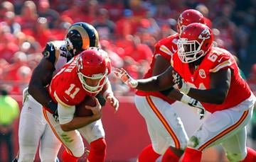 KANSAS CITY, MO - OCTOBER 26:   Alex Smith #11 of the Kansas City Chiefs is tackled by  Robert Quinn #94 of the St. Louis Rams  at Arrowhead Stadium on October 26, 2014 in Kansas City, Missouri.  (Photo by Kyle Rivas/Getty Images) By Kyle Rivas