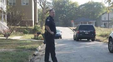 An officer stands guard after human remains were found in Atlanta's English Avenue neighborhood. By Stephanie Baumer