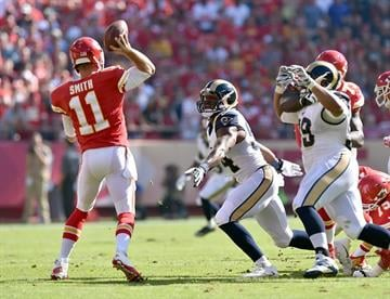 KANSAS CITY, MO - OCTOBER 26:   Alex Smith #11 of the Kansas City Chiefs passes against the St. Louis Rams during the first half at Arrowhead Stadium on October 26, 2014 in Kansas City, Missouri.  (Photo by Peter Aiken/Getty Images) By Peter Aiken