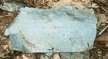 A recovered aluminum metal patch bears high similarity to a unique patch on Amelia Earhart's aircraft, says an aircraft recovery group. By Stephanie Baumer