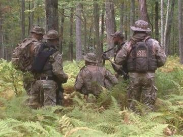 The Bureau of Alcohol, Tobacco, Firearms and Explosives released this image through its Twitter stream Sunday, Sept. 21, 2014, showing agents searching for suspected cop-killer Eric Matthew Frein. By ATF