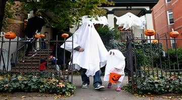 """NEW YORK, NY - OCTOBER 31:  The Abrahms family of Fort Greene, Brooklyn """"trick or treat"""" as Brooklyn residents participate in Halloween activities on October 31, 2012 in New York City.  (Photo by Jemal Countess/Getty Images) By Jemal Countess"""