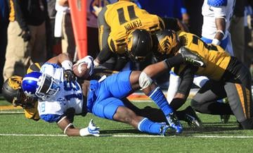 The Missouri Tigers defense stops Kentucky Wildcats Glenn Faulkner during a running play in the second quarter at Faurot Field in Columbia, Missouri on November 1, 2014. UPI/Bill Greenblatt By BILL GREENBLATT