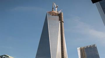 New York City's One World Trade Center reached its full height of 1,776 feet with the addition of the spire's cap placed early Friday morning, May 10, 2013. By Fred Schang