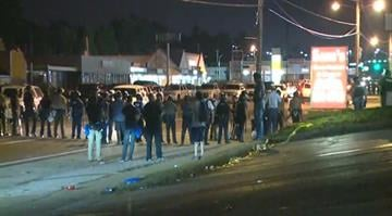 Tuesday night started calm and escalated quickly once bottles and urine were thrown at police. By Stephanie Baumer