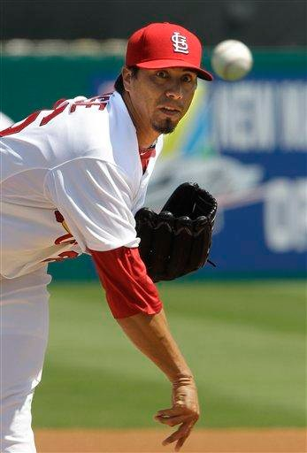 St. Louis Cardinals starting pitcher Kyle Lohse (26) throws during the second inning of spring training baseball game against the Atlanta Braves, Monday, March 14, 2011, in Jupiter, Fla. (AP Photo/Carlos Osorio) By Carlos Osorio