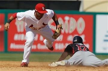 Atlanta Braves' Matt Young (17) slides under the tag of St. Louis Cardinals second baseman Daniel Descalso during the ninth inning of a spring training baseball game, Monday, March 14, 2011, in Jupiter, Fla. (AP Photo/Carlos Osorio) By Carlos Osorio